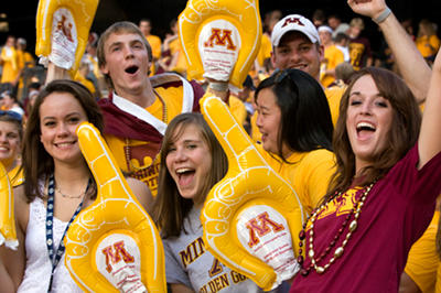 students cheering at U of M game